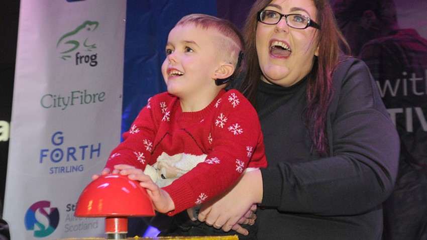 Image of Boy and Mum Switch on Christmas Lights