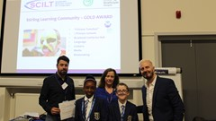 Pupils and staff from Stirling Learning Community collect their award