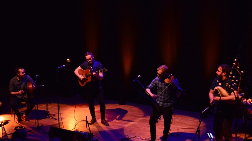Image of A group of musicians playing at the Tolbooth