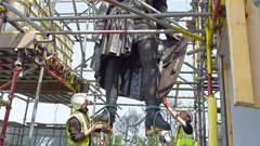 Statue Being Hoisted