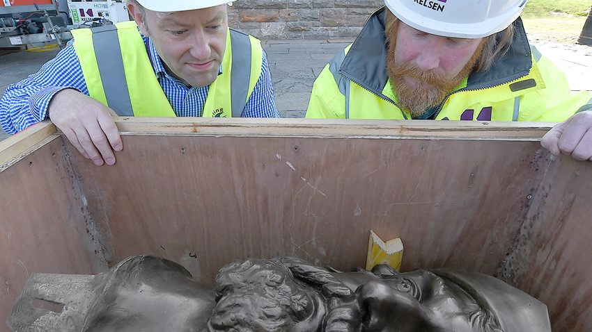 Statue Head in Shipping Container