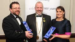 Alasdair Gammack presenting the after dinner speakers Dr Murray Cook & Ailsa Stanwix with their customary Guildry golbets