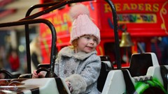 Child on Carousel at Christmas Lights Switch on Event
