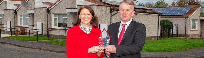 Picture shows Cllr Evelyn Tweed (Hosing Portfolio Holder for Stirling Council) at Easton Court, Raploch, holding the award with Gregor Whiteman, Property & Private Sector Housing Manager with Stirling Council's Housing Services.