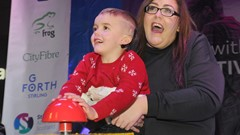 Boy and Mum Switch on Christmas Lights