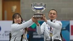 Wheelchair Athletes Raising a Cup