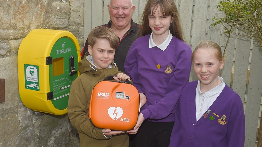 Children Holding AED Pack