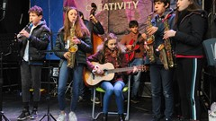 Band playing at Alive with Creativity event