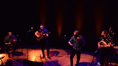 A group of musicians playing at the Tolbooth