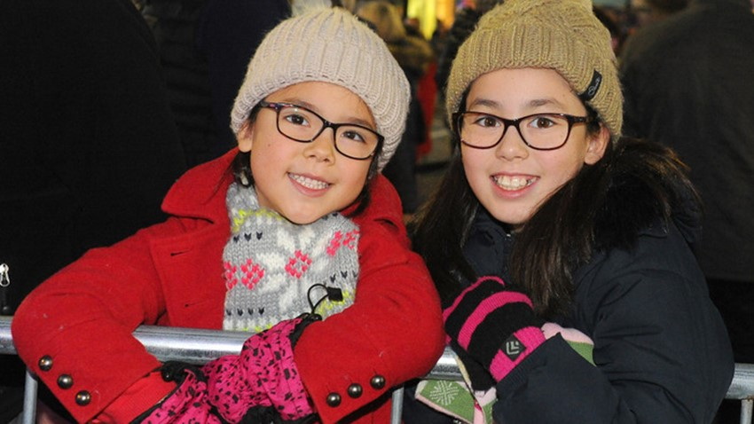 Image of Girls Enjoying Christmas Lights Switch on Event