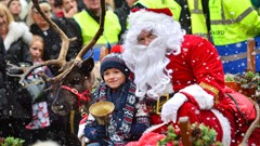 Boy with Santa on Sleigh