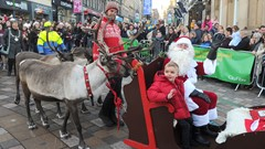 Boy in Sleigh with Santa for Stirling Christmas Light Switch on