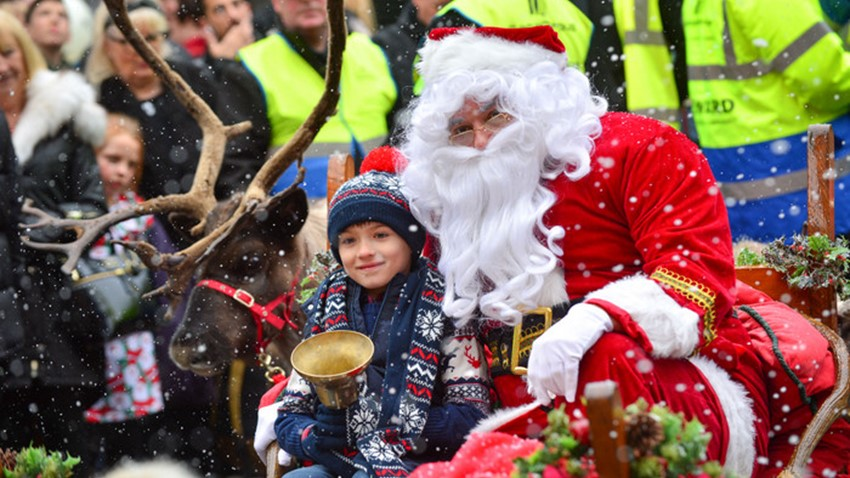Image of Boy with Santa on Sleigh