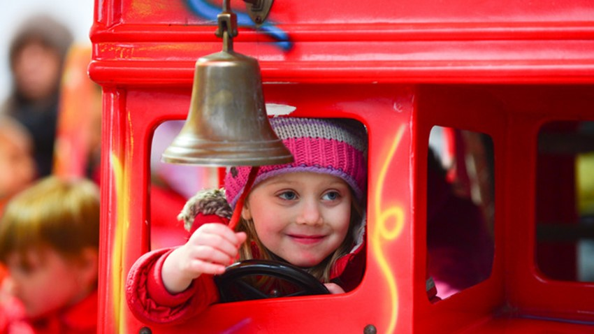 Image of Child on Carousel at Christmas Lights Switch on Event