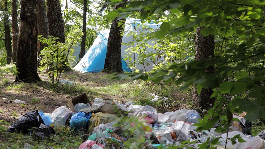 Image of Rubbish bags and tent equipment discarded at a site in rural Stirling