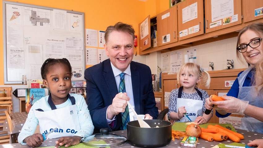 Atiyyah Lawal (4) and Rosie Bechelli (5) with Chief Executive of the Care Inspectorate, Peter Macleod