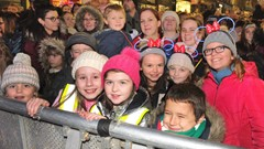Children waiting on Christmas Tree Light Switch on