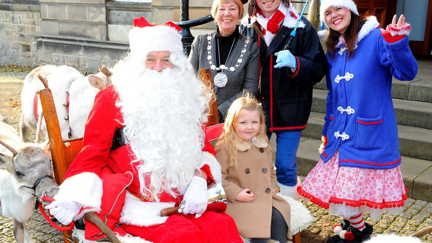 Image of Provost with Santa and Helpers
