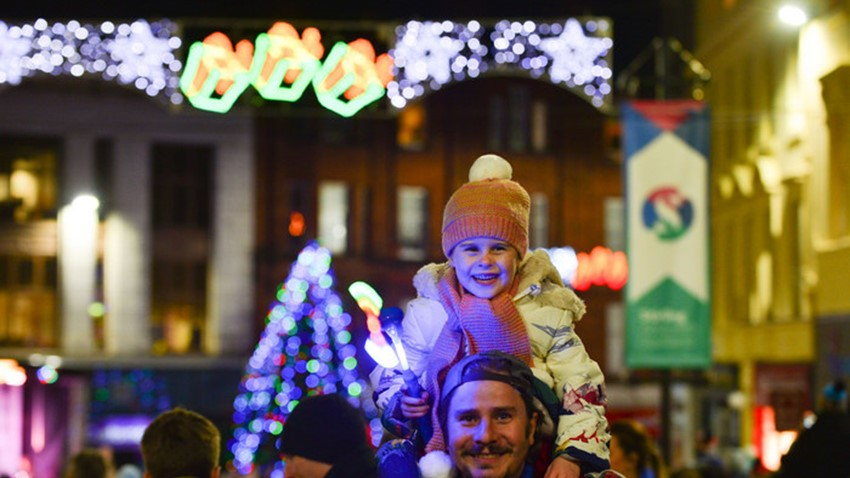 Image of Dad and Daughter celebrate Christmas Light Switch On
