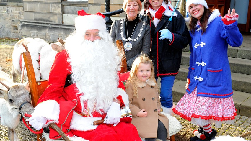 Image of Provost and Guests visiting Santa's Sleigh
